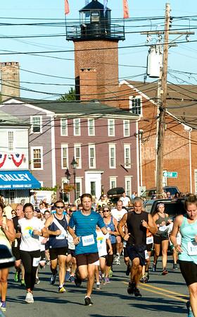 BRYAN EATON/Staff photo. Runners in the 5K race head up Water Street into downtown Newburyport.