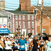 BRYAN EATON/Staff photo. Runners in the 5K race head up Water Street into downtown Newburyport.