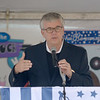 JIM VAIKNORAS/Staff photo Yankee Homecoming General Chairman Paul Swindlehurst speaks during the opening ceremonies at Old Fashioned Sunday on the Bartlet Mall.
