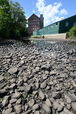 BRYAN EATON/Staff photo. In a repeat of last summer, the Powow River at the Lower Millyard in Amesbury is almost non-existent as the regional drought continues. Showers are predicted which should give a little relief to lawns and people's gardens.