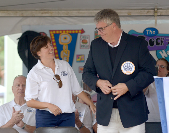 JIM VAIKNORAS/Staff photo Yankee Homecoming General Chairman Paul Swindlehurst is presented his jacket by last years chairman Jennifer Lacroix during the opening ceremonies at Old Fashioned Sunday on the Bartlet Mall.