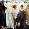 BRYAN EATON/Staff photo. Rosanne DeLuca of Haverhill, left, and helps friend Judi Bove of Plum Island choose a dress for a wedding she's attending in a couple weeks at an outdoor sale at Pure Bliss.