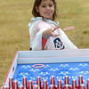 JIM VAIKNORAS/Staff photo Gwen Zappasodi, 5, of Merrimac Ma tries the ring toss at Old Fashioned Sunday at the Bartlet Mall.