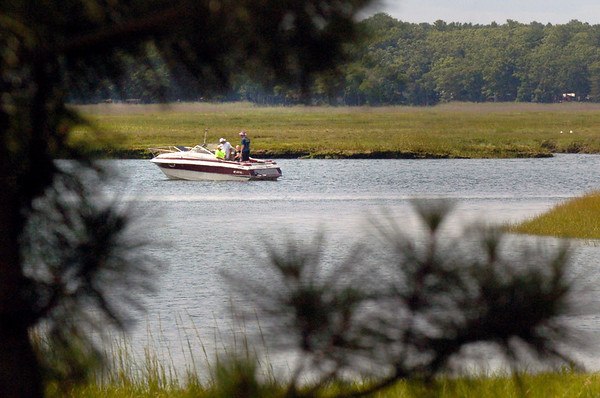BRYAN EATON/Staff photo. Fisherman drop their lines in Black Rock Creek off the Merrimack River in the marshes of Salisbury Beach State Reservation on Tuesday afternoon.