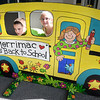 BRYAN EATON/Staff photo. Siblings Nate Gallant, 8, left and Amelia, 7, pose in a school bus cutout at the Sweetsir School in Merrimac yesterday. The PTO sponsored the Merrimac Goes Back to School event ahead of today's start of schools in the Pentucket District.