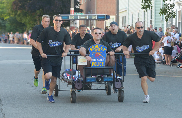 JIM VAIKNORAS/Staff photo. The Rowley Police Dept had their sirens blaring as they make their way down Federal Street in the annual Lions Club Bed Race.