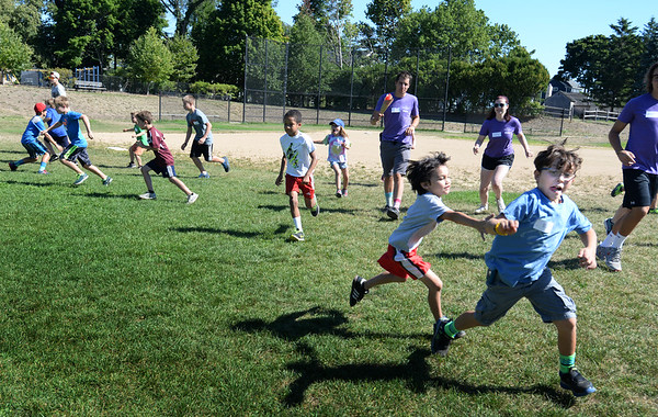 BRYAN EATON/Staff photo. Children play Fishy, Fishy Cross My Ocean which is similar to Capture the Flag at the Perkins Playground in Newburyport on Monday. They were in the Clipper Kids Program at Newburyport Youth Services.