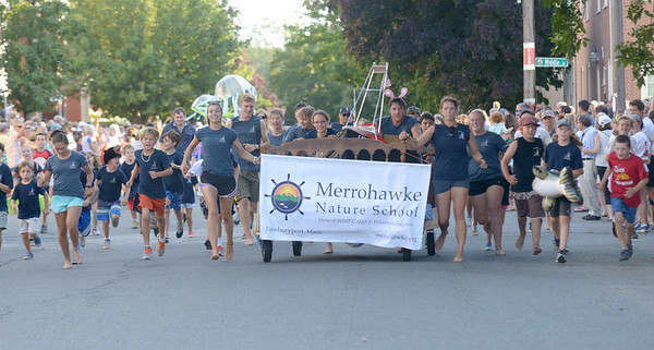 JIM VAIKNORAS/Staff photo. Merrohawk Nature School runs down Federal Street in the annual Lions Club Bed Race.