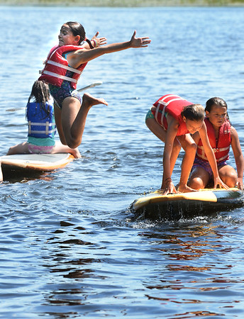BRYAN EATON/Staff photo. Youngsters frolic at Camp Kent on Lake Gardner in Amesbury during paddleboarding and swimming time at the town's Recreational Department's Summer Camp where they had been kayaking earlier. In the water will be the place to be the next couple days at the temperature will reach into the 90's along with some humidity.