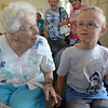 JIM VAIKNORAS/ Staff photo  Two of Rowley's Human Library's Doris Bradstreet and Bryce Porter enjoy a talk as the  Rowley Library celebrates it's 125 birthday. 10 residents were nominated and selected to act as Human Libraries based on their knowledge, Doris know the history of Rowley and Bryce 6, is an expert on Marine Biology.