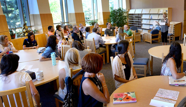 BRYAN EATON/Staff photo. Patty Hoyt talks to new teachers in the Amesbury School system as they pair up with mentors--veteran teachers--in an orientation in the library at Amesbury High School.