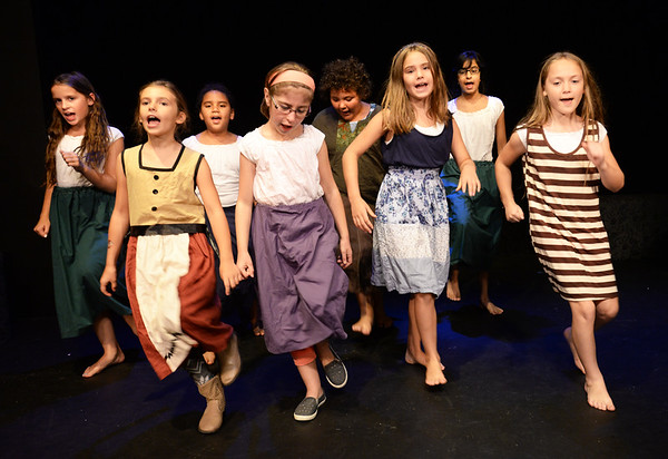 """BRYAN EATON/Staff photo. The """"orphans"""" perform the song """"It's a Hard Knock Life."""""""
