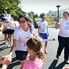 BRYAN EATON/Staff photo. Runners in the Sri Chinmoy Oneness-Home Peace Run, a 10,000 mile torch relay, greet children from the YWCA's Schools Out Program on a stop at the Bresnahan School in Newburyport. Traveling the world to encourage goodwill, harmony and friendship at the local level, there have been relays in over 140 countries.