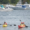 JIM VAIKNORAS/Staff photo Kayakers navagate the Merrimack River off Market Landing Park in Newburyport Sunday morning.