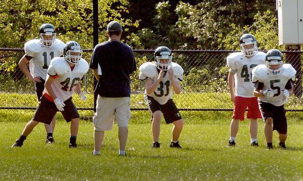BRYAN EATON/Staff photo. Pentucket High football defensive line go through drills.