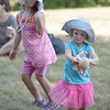 JIM VAIKNORAS/Staff photo Ciara Jalbert, 5, and Kennedy Welch, 3, dance to the songs of the Stacey Peasley Band at Family Day at Maudslay Saturday.