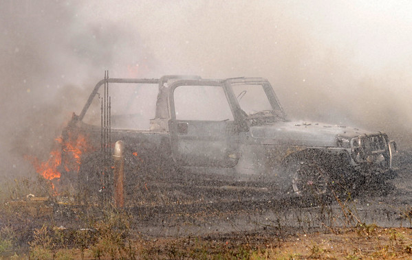 JIM VAIKNORAS/Staff photo One of several cars were destroyed during the fire on 20th Street on Plum Island Saturday.
