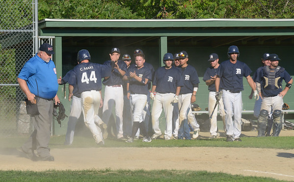 JIM VAIKNORAS/ Staff photo Manchester players congradulate John Wilcox after he scores during their championship game at Erias Field in Rowley. Manchester won the game 3-2.