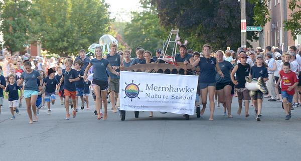 JIM VAIKNORAS/Staff photo. Merrohawk Nature School runs down Federal Street in the annual Lions Club Bed Race.