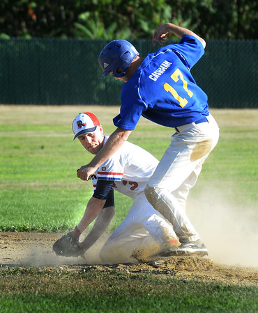 BRYAN EATON/Staff photo. Rams' Tim Cashman makes it second safely with a late throw to Rockport second baseman Fulmer.