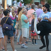 JIM VAIKNORAS/Staff photo. Teddy Speck from Theater in the Open entertains the crowds as their bed makes it's down Federal Street in the annual Lions Club Bed Race.
