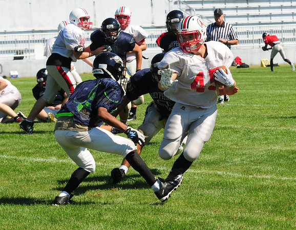 JIM VAIKNORAS/Staff photo Amesbury's #45 Jared B runs for yardage during a scrimmage against Greater Lowell