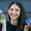 BRYAN EATON/Staff photo. Sixteen year-old Newburyport High junior Samantha Raskind has won several Rubik's Cube competitions and plans to attend one in Paris.