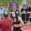 JIM VAIKNORAS/Staff photo Atlantic Pro Wrestler Mistress Belmont argues with Ed Hunt Jr during one of their matches at Old Fashioned Sunday at the Bartlet Mall.