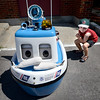 "BRYAN EATON/Staff photo. Luke Coppi, 6, of Wellesley checks out ""Coasties"" an animated boat that the U.S. Coast Guard Auxilliary uses to entertain and educate youngsters. He was at the Open House with his grandfather Wilfred Bernier of Newburyport."