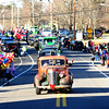JIM VAIKNORAS/Staff photo Antique cars head up Church Street during the  Annual Merrimac Santa Parade.