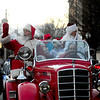 JIM VAIKNORAS/Staff photo Santa and Mrs Claus make their way towards Market Square on a vintage  fire truck  in Amesbury Saturday after noon in the city's annual Santa Parade.
