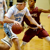 BRYAN EATON/Staff photo. Triton plays Newburyport at Triton in the Rowinski Holiday Tournament. Triton's William Parsons moves past Newburyport guard Ronnie Mwai.