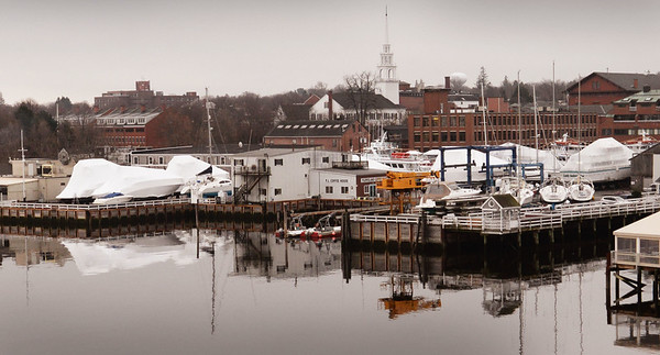 BRYAN EATON/Staff photo. Present view of the Newburyport Waterfront between the Black Cow, left, and Michael's Harborside which New England Development has submitted plans to develop.