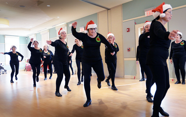 BRYAN EATON/Staff photo. The ballet and tap class at the Newburyport Senior Citizen Center performed during their Holiday Party on Wednesday afternoon. Santa Claus was on hand as were refreshments and some participated in a Yankee Swap.
