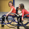 BRYAN EATON/Staff photo. Northeast Passage program, administerd through the University of New Hampshire, was at the physical education classes at the Breshanan School in Newburyport on Wednesday. They promote adaptive sports recreational therapy and were teaching students about inclusion of those with disabilities by playing tag in wheelchairs. Kindergartner Adelaide Fruh, 6, laughs as classmate Maggie Blaser, 6, slaps the tag on her.