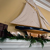 BRYAN EATON/Staff photo. Two of the homes on the Holiday House Tour to benefit the Custom House Maritime Museum. A nautical-themed mantel in the Clay home.