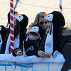 JIM VAIKNORAS/Staff photo Penguins from Troop 13976 ride a float during the  Annual Merrimac Santa Parade.