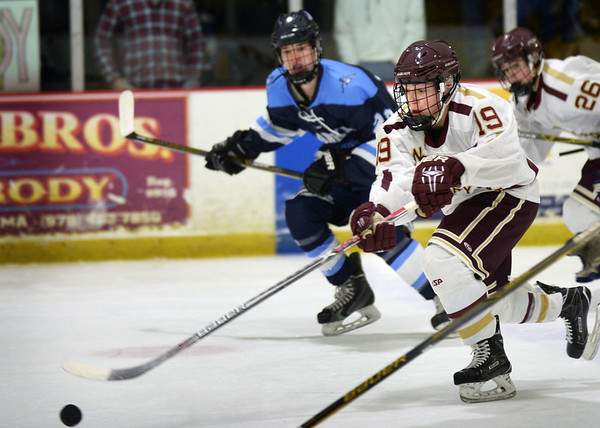BRYAN EATON/Staff photo. Newburyport High School hosts Franklin High School at the Graf Rink. Newburyport's Cole Spence moves the puck into Franklin ice.