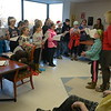 JIM VAIKNORAS/Staff photo The Amesbury Middle School Melody Club under the direction of Johanna Kimbal sing Christmas Carols and Holiday songs to residence of Maplewood Manor in Amesbury Thursday afternoon.