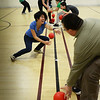 BRYAN EATON/Staff Photo. Younsters and counselors scramble for balls at the start of several games of Apache dodgeball at the Newburyport Rec Center on Wednesday. The center, run by the Newburyport Department of Youth Services, will be closed during school vacation next week.