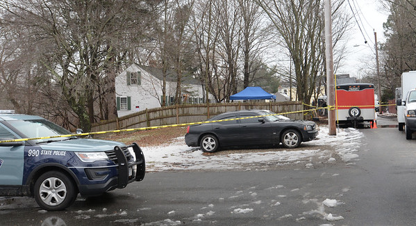 BRYAN EATON/Staff photo. Local and state police along with the FBI have been searching a home, white at left, and the grounds of 4 Chestnut Street in Georgetown. Very little information is being made to the public. Chestnut runs south of East Main Street just a half mile east of the town's center.
