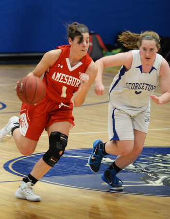 BRYAN EATON/Staff photo. Georgetown girls basketball hosts Amesbury. Amesbury's M. Napoli moves down court past Georgetown's Caitlin Donoghue.