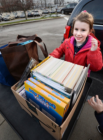 BRYAN EATON/Staff photo. Harley Edwards, 8, of Georgetown delivered some children's coloring books to the Anna Jaques Hospital which she asked for in lieu of birthday presents from friends. She and little brother, George, 5, and mom Desiree made the delivery Tuesday.