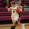 JIM VAIKNORAS/Staff photo Newburyport's Anna Hickman is fouled after making a steal against Gloucester during their game at Newburyport High school Wednesday night.