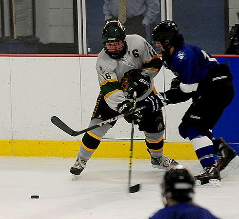 JIM VAIKNORAS/Staff photo Pentucket's Nate McCarthy fights for the puck with a Bedford player  during their game in Haverhill Wednesday.