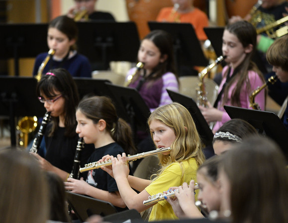 BRYAN EATON/Staff photo. Fifth and sixth grade students in advanced band at Newbury Elementary School perform a medley of Christmas songs at the afternoon session of their Winter Concert on Tuesday afternoon. The school's band and chorus performed for parents later in the evening.