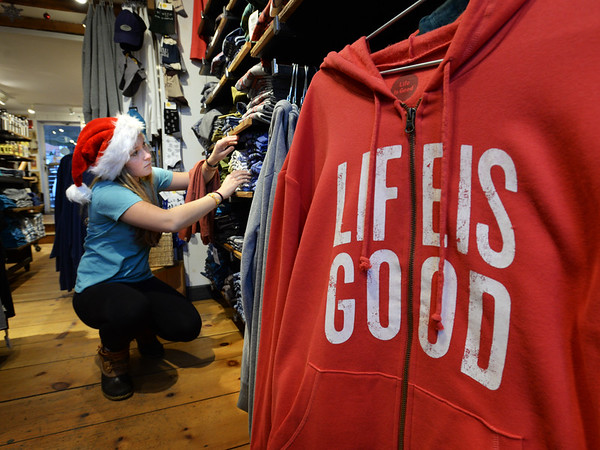 BRYAN EATON/Staff photo. Sarah Pokelwaldt works at Life Is Good, one of several businesses staying open late Friday and participating in different events.
