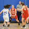 BRYAN EATON/Staff photo. Georgetown girls basketball hosts Amesbury. Georgetown's Nicole Donnelly moves in on Amesbury's Mikayla Porcaro.
