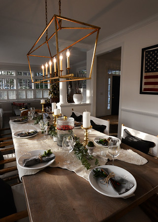 BRYAN EATON/Staff photo. Two of the homes on the Holiday House Tour to benefit the Custom House Maritime Museum. Dining room table in the Anderson home.