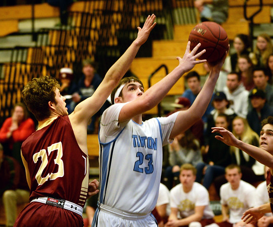 BRYAN EATON/Staff photo. Triton plays Newburyport at Triton in the Rowinski Holiday Tournament. Newburyport's Brendan Powers covers Triton's William Parsons.